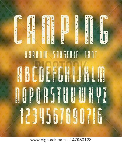 Narrow sanserif font with speckled texture. Bold face. White print on autumn blurred background