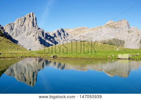Peaks reflected in Ansabere Lake. Lescun Cirque. Aspe Valley, Pyrenees, France.