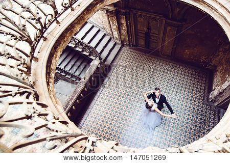 Newlyweds Dancing In An Old House