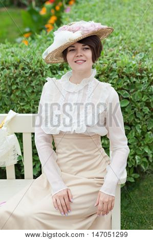 Beautiful young woman in dress and hat portrait in retro style. Vogue dressing in vintage style