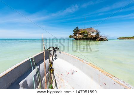 the Rock restaurant in ocean on the horizon, colorful view from a boat, Zanzibar