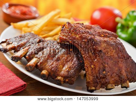 Barbecued Pork Baby Back Ribs with fries