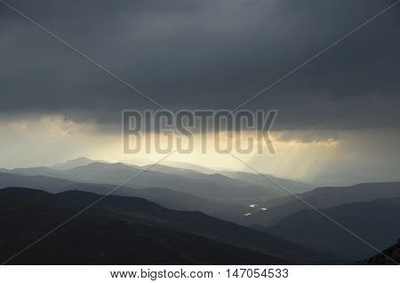 The summit of the 841 metre peak of Ben Vrackie near Pitlochry in the Highlands of Scotland UK provides spectactular views of the surrounding hills and peaks
