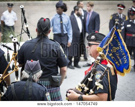 NEW YORK-SEPT 9 2016: Members of Wilmington NC Pipes and Drums line up after performing in NYPD Emerald Society Pipe and Drums 9/11 Memorial Procession on the 15th anniversary of the terror attack.