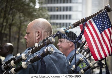 NEW YORK - SEPT 9 2016: Members of Bergen County Pipes and Drums line up on Broadway at the NYPD Emerald Society Pipe and Drums 9/11 Memorial Procession on the 15th anniversary of the terror attacks.