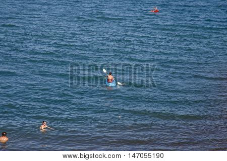Masaya Nicaragua - March 12 2016: Apoyo Lagoon view with people on recreation in sunny day on summer.