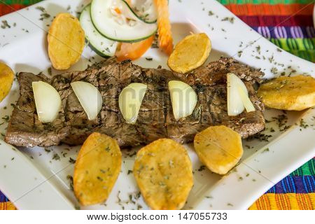 beef steak cooked with onion and platan