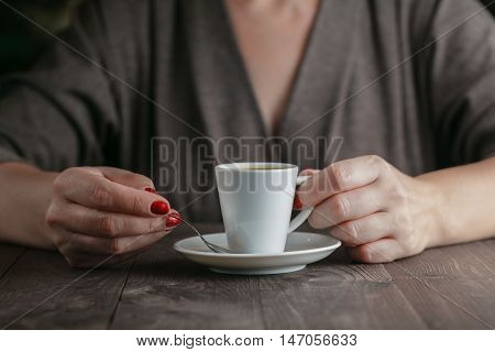 Woman Hands With Espresso On A Wood Table