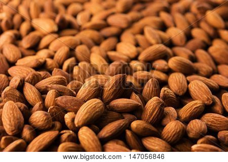 High grade almonds, dry roasted and unsalted. Shot with depth. Shallow depth of field.