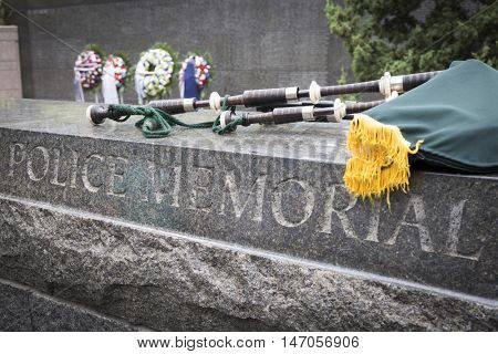 NEW YORK - SEPT 9 2016: A bagpipe placed on the stone wall of the New York City Police Memorial after the 9/11 Memorial Commemoration Service on the 15th anniversary of the terror attacks.