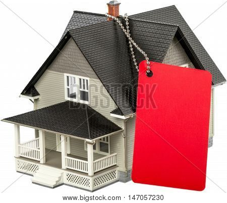 Model of a House with Red Gift Tag - Isolated