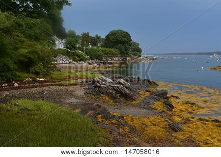 Rocky coast of Bustin's Island in Casco Bay Maine.