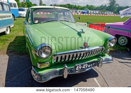 Kharkiv Ukraine - May 22 2016: Soviet retro car bright green sedan GAZ M21 Volga Second Series manufactured between 1959 and 1962 is presented at the festival of vintage cars Kharkiv Retro Rally - 2016 in Kharkiv Ukraine on May 22 2016