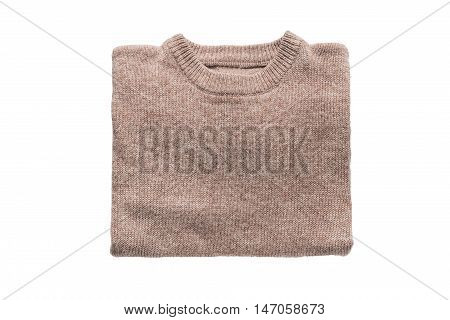 Beige cashmere pullover folded on white background