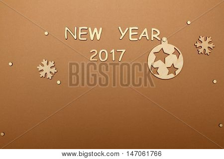 Background with snowflakes and Christmas tree ball and the text of the new 2017