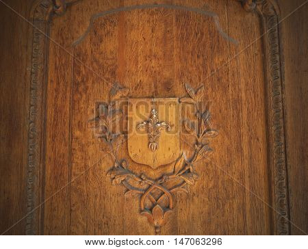 Wooden bas-relief on the door in the old style