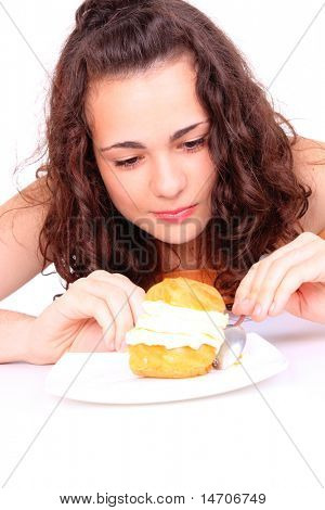 A Young girl eating a yumy cake