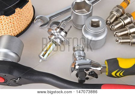 Air Filter, Sparkplugs, Wrench Sockets And Different Wrenches Close-up