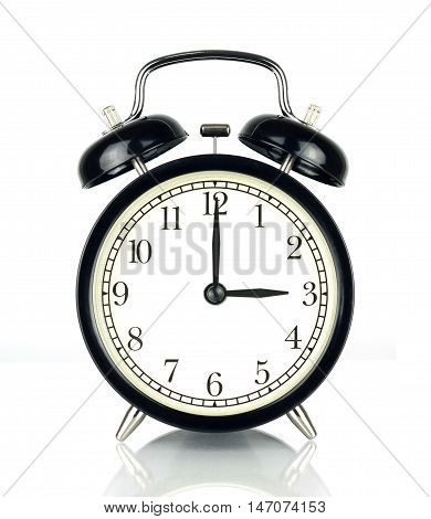 Alarm Clock isolated on white in black and white showing three o'clock.