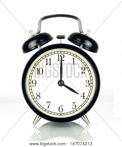 Alarm Clock isolated on white in black and white showing four o'clock.
