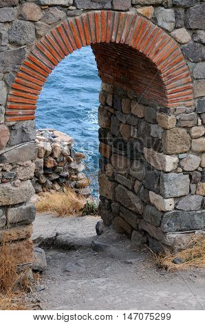 Arch of the ruined fortress tower in the town of Sozopol in Bulgaria