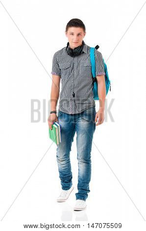Full length portrait of a caucasian guy student of college or university with backpack and book. Casual young male isolated white background. Teen boy look at camera, walking and holding book.