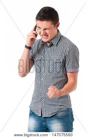 Angry man with phone isolated on a white background. Portrait of sad teen boy holding cellphone and yelling. Annoyed teenager with mobile phone.