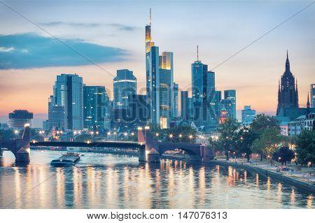 Evening view of Frankfurt city skyline over Alte Brucke bridge