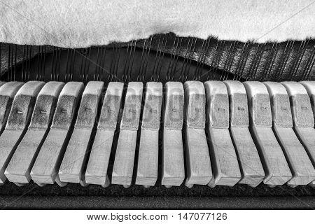 inside  a piano , wooden parts, mechanisms closeup