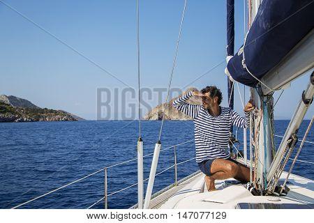 Young Man On Sailiboat