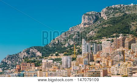 Monaco, Monte Carlo Architecture On Mountain Hill Background. Many Multi-story Houses, Buildings.