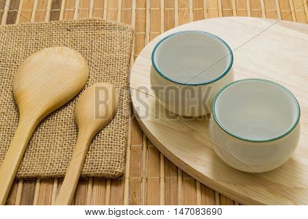 Trencher and cups on the wooden background