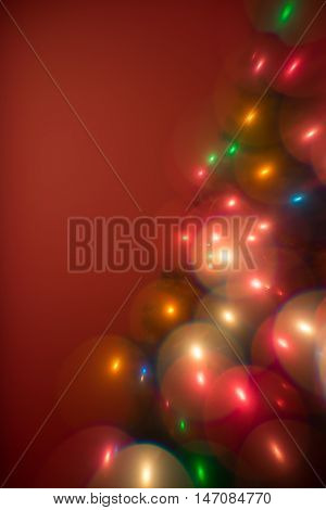 Decorative multi color christmas tree lights bokeh like bubbles on a red background