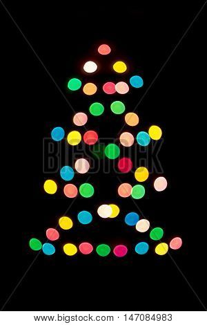 Decorative multi colour balls. Decorative multicolour Christmas tree. Blue, orange, green, white and red bubbles