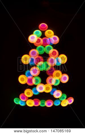 Decorative multicolour lighting Christmas tree. Decorative multicolour Christmas tree. Blue, orange, green, white and red bubbles