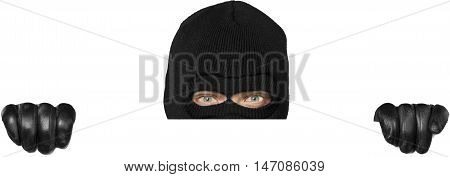 Close-up of a Thief with Balaclava Behind Blank Wall