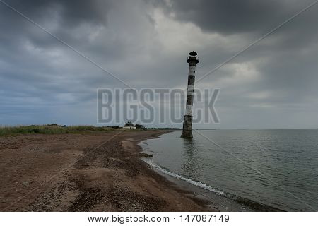 Skew lighthouse in the Baltic Sea. Stormy night on the beach. Kiipsaar Harilaid Saaremaa Estonia Europe.