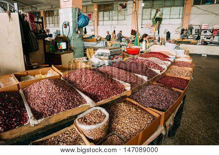 Batumi, Georgia - May 28, 2016: The Diversity Of Varicolored Sorts Of Raw Dry Beans In Bulk In Wooden Trays For Sale At Showcase Of Market, Bazar. Batumi, Adjara, Georgia.