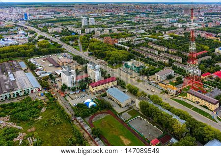 Tyumen, Russia - August 9, 2015: Bird eye view on bus station, prosecutor office of Central joint-stock company, TV towers and residential districts at summer