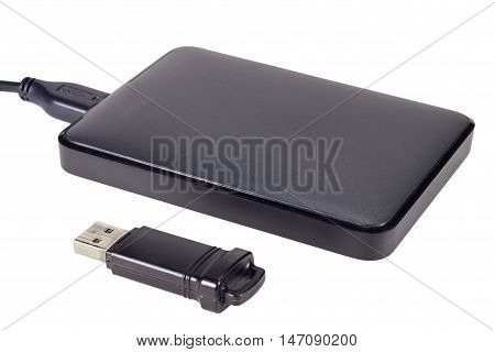 External hard drive and USB drive isolated on white background