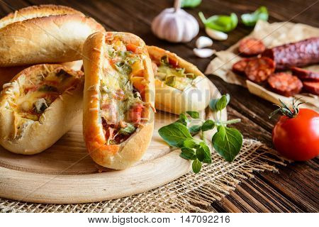 Bread Boats Filled With Sausage, Egg And Cheese