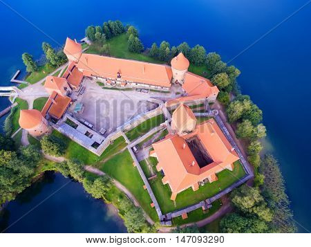 Trakai, Lithuania: aerial UAV top view, flat lay of Island Castle in the sunrise. Historical residence in capital city of Grand Duchy of Lithuania, located in Galve lake