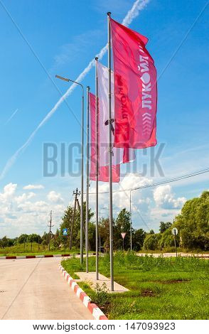 BOROVICHI RUSSIA - JUNE 26 2016: The flags of the oil company Lukoil on the gas station. Lukoil is one of the largest russian oil companies