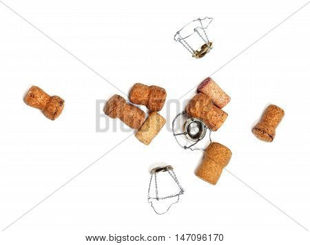 Corks from champagne wine and muselets. Isolated on white background with copyspace. View from above.