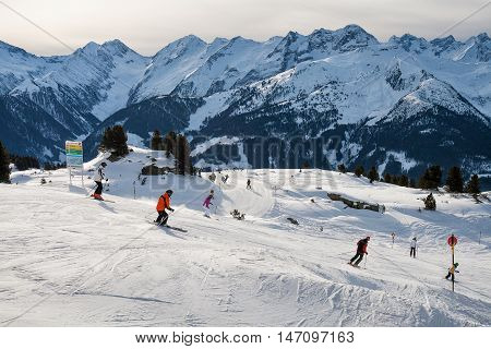 ZILLERTAL ARENA AUSTRIA - JANUARY 04 2011 - Group of skiers skiing down the mountain ski slopes