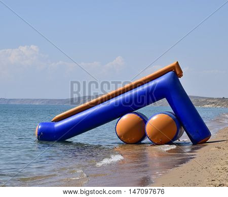 Inflatable slide to slide into the water. Children's attraction.