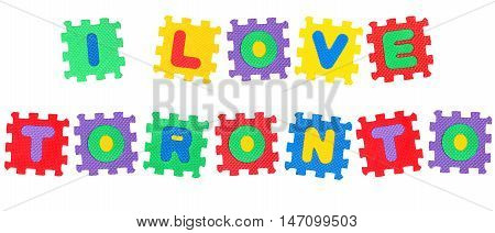 Message I Love Toronto from letters puzzle isolated on white background.