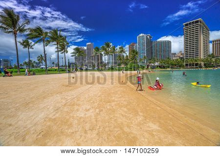 Waikiki, Oahu, Hawaii - August 18, 2016: Hilton Hawaiian Village to the left of Duke Kahanamoku Beach. The beach is one of more popular of Waikiki Beaches because it offers a swimming area protected.