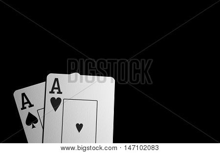 Two Aces On A Black Background. Red And Peak Ace Close Up.