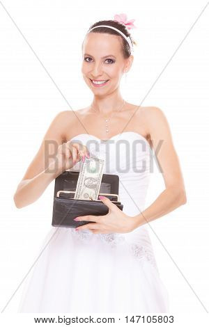 Bride with one dollar and wallet. Young girl holding purse and money cash. Wedding expenses costs expenditure. Marriage and finance concept. Woman in white wedding dress isolated on white background.